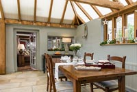 Dining area in wooden conservatory