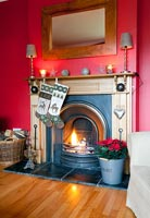 Christmas stockings hanging by fire