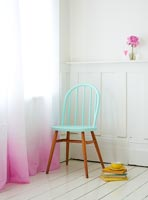 Pastel chair and dip dye curtain