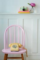 Pastel pink chair and telephone
