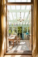 Conservatory with vintage furniture
