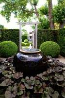 Formal garden with water feature