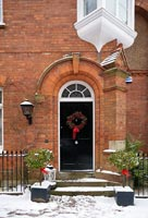 Victorian house entrance decorated for christmas