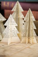 Using old books to create unique Christmas tree decorations - finished trees