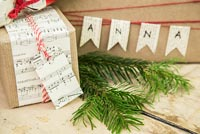 Christmas present wrapped in music sheet paper