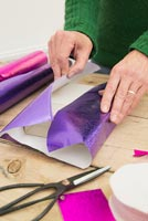 Wrapping christmas presents in decorative paper