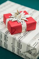 Christmas presents wrapped in sheet music