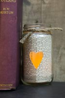 Lantern made from old jar and newspaper