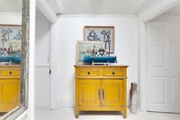 Yellow cabinet in hallway