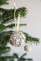 Step by Step guide for making paper cones using music sheet paper - finished bauble on tree
