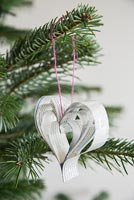 Creating a heart shaped decoration using newspaper and coloured thread - finished hearts