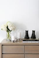 Modern accessories on chest of drawers