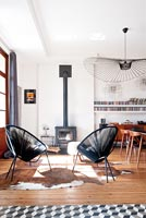Black chairs in front of stove