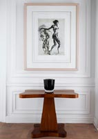 Black and white print hung above classic table