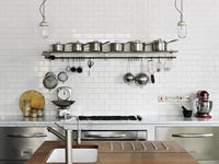 Pots and pans on kitchen shelf