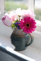 Posy of Roses and Gerberas in pottery jug