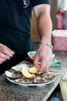 Preparing plate of oysters