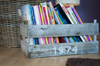 Old wooden box with magazines