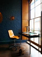 Leather chair and glass desk