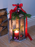 Wooden christmas lantern with Fir branch