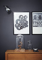 Monochrome art above sideboard