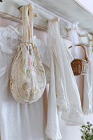Vintage clothing hanging from pegs