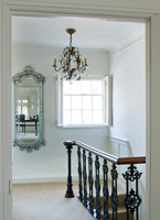 Classic landing with vintage chandelier and reclaimed iron  bannisters