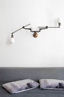 Industrial style lighting above bed