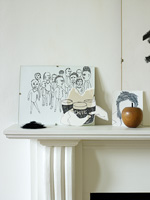 Black and white drawings on mantlepiece