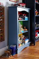 Blue shelving in childs bedroom