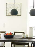 Monochrome tableware on wooden dining table