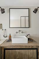 Modern bathroom sink on wooden cabinet