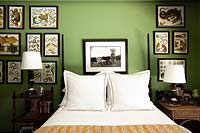 Natural history prints around bed