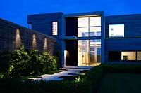 Contemporary house lit up at night