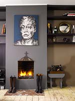 Portrait painting above fireplace