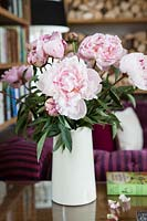 Pink Peony flowers in white jug