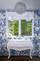 Glass sink on ornate washstand