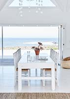 Open plan dining area with sea view