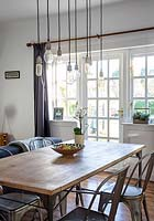 Pendant lights above dining table
