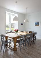 Wooden dining table and painted chairs