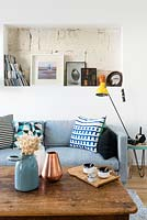 Blue sofa with storage alcove above