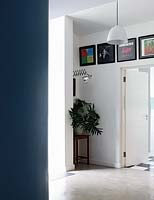 Framed record sleeves above door
