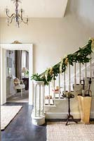 Christmas garland wrapped around bannisters
