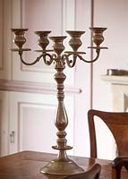 Pewter candelabra on antique dining table