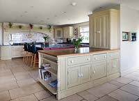 Country style kitchen diner with limestone flooring