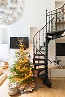 Christmas tree by spiral staircase
