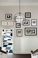 Black and white photo display on hall wall