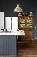 Vintage wooden dresser in modern kitchen