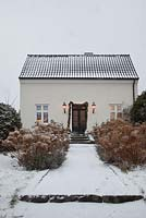 House and garden in snow