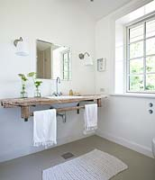 Bathroom sink on wooden counter